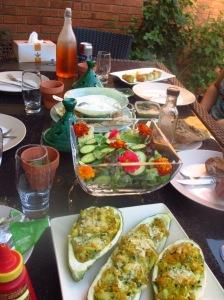 A dinner of stuffed zucchini flowers, stuffed zucchinis, garden greens from my garden and edible marigolds and nasturtium