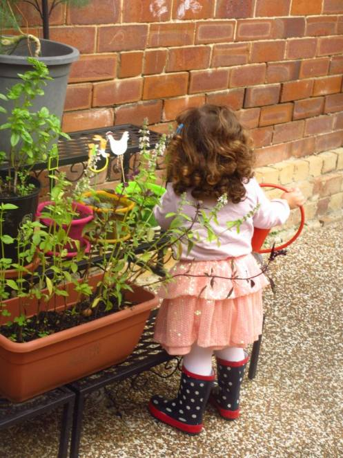 My daughter watering her plants